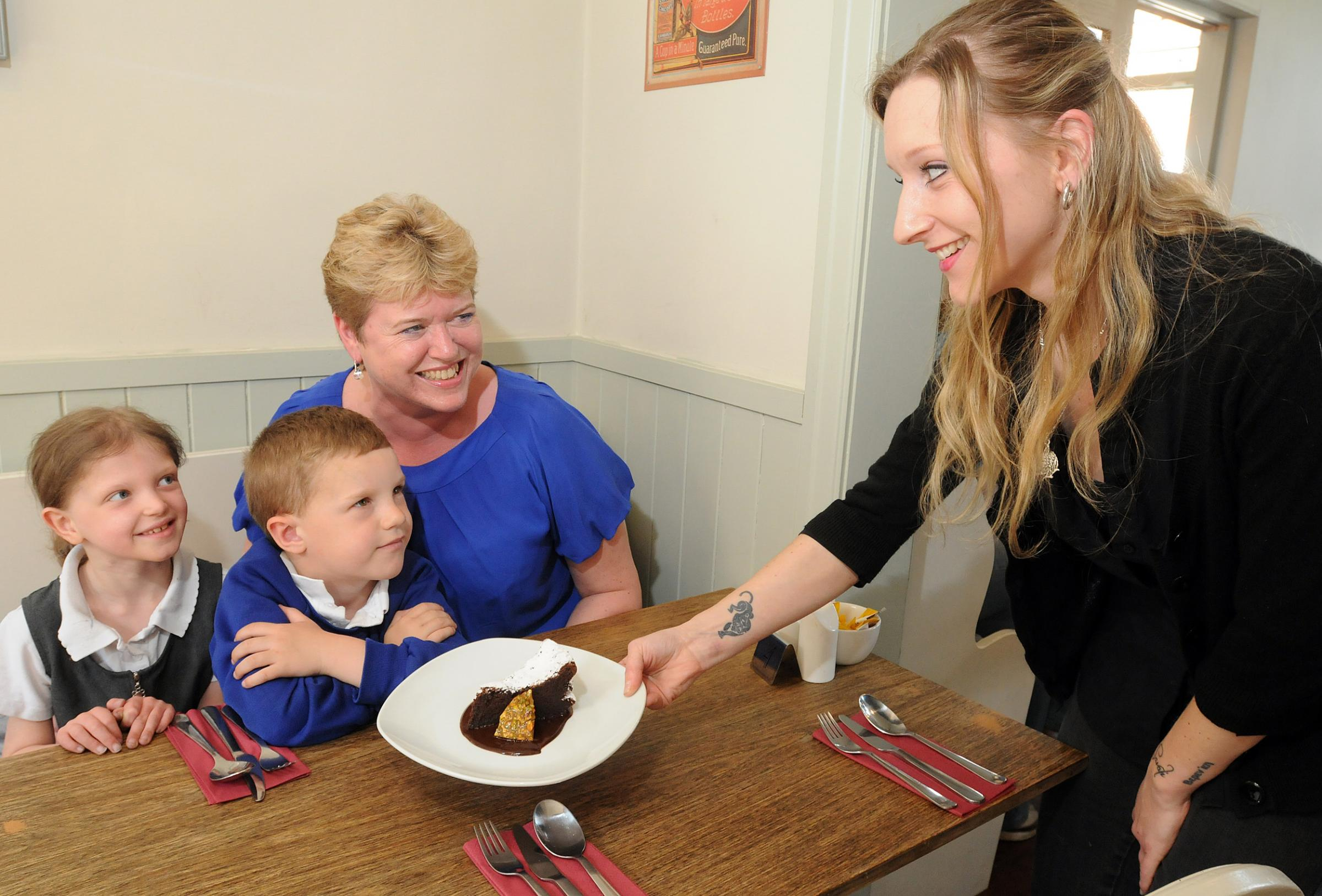 Westfield Primary Community School teacher Tracey Ralph and her pupils Jodie Foster (8)  and James Dickinson (4) visited Conlons Cafe and Bistro and were served with gluten free meals by co owner Sava Allott as part of Coeliac .