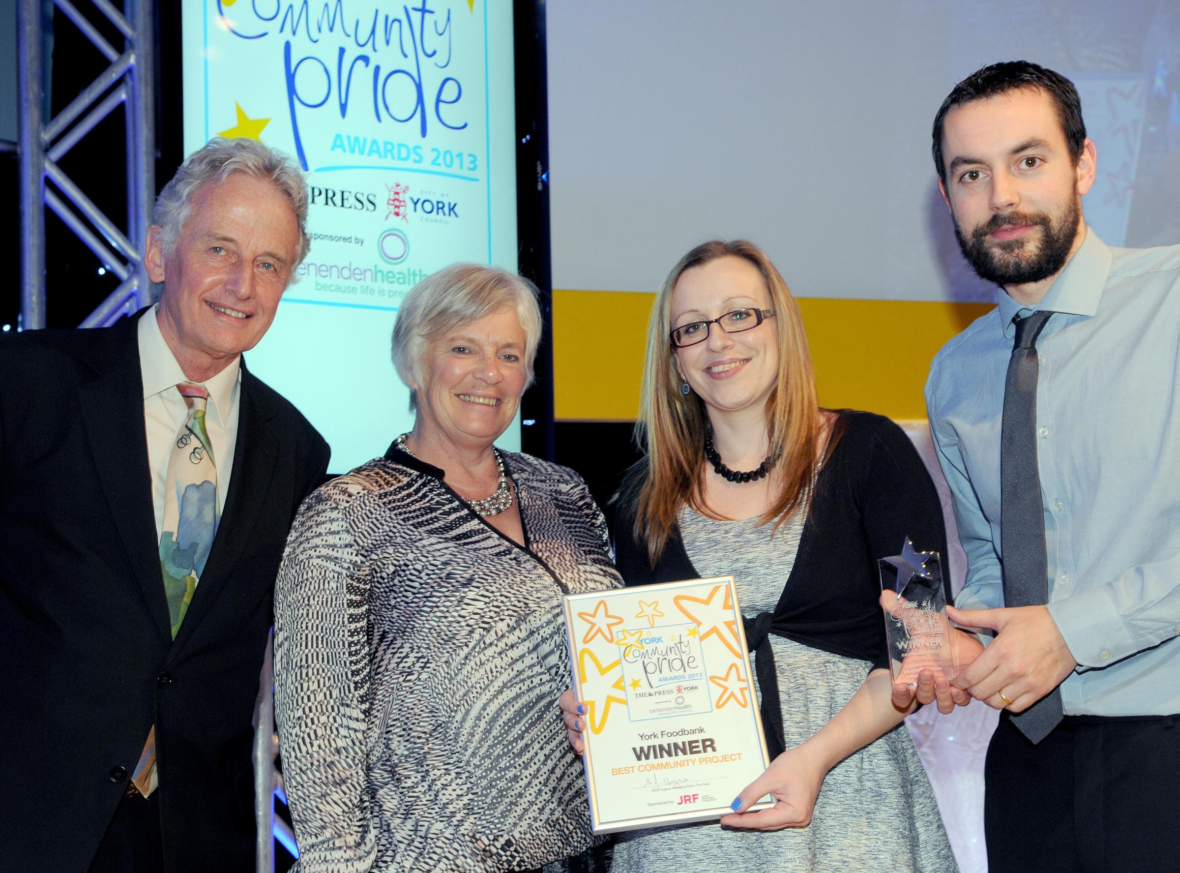 John Low (left) of the Joseph Rowntree Foundation with members of York Foodbank (from left) Helen Dunville, Tess Sherratt and Caleb Ellwood, winners of the Best Community Project in 2013 at last year's awards ceremony.