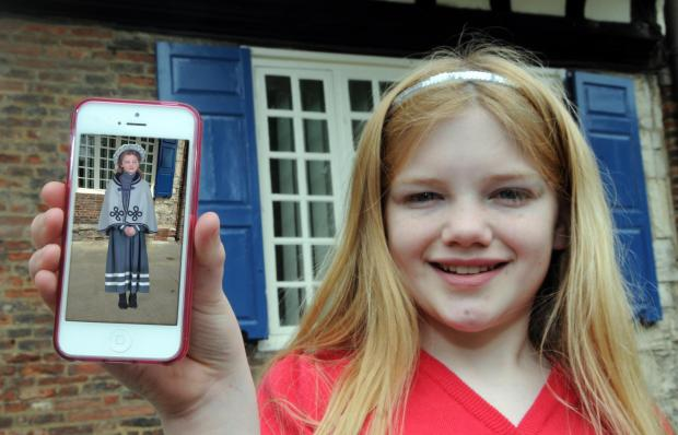 Francesca Turton shows her 3D hologram character Edwina, on her phone.