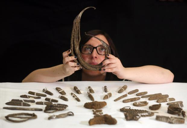 Natalie McCaul, curator of archaeology with a unique Viking silver neck ring from The Bedale Hoard