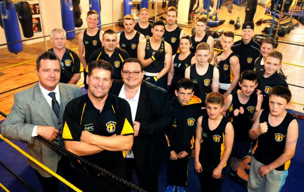 Henry with sponsors Dean Sherriff (left) and Mark Stanley from Empire Tapes PLC with squad members at his Acomb gym.