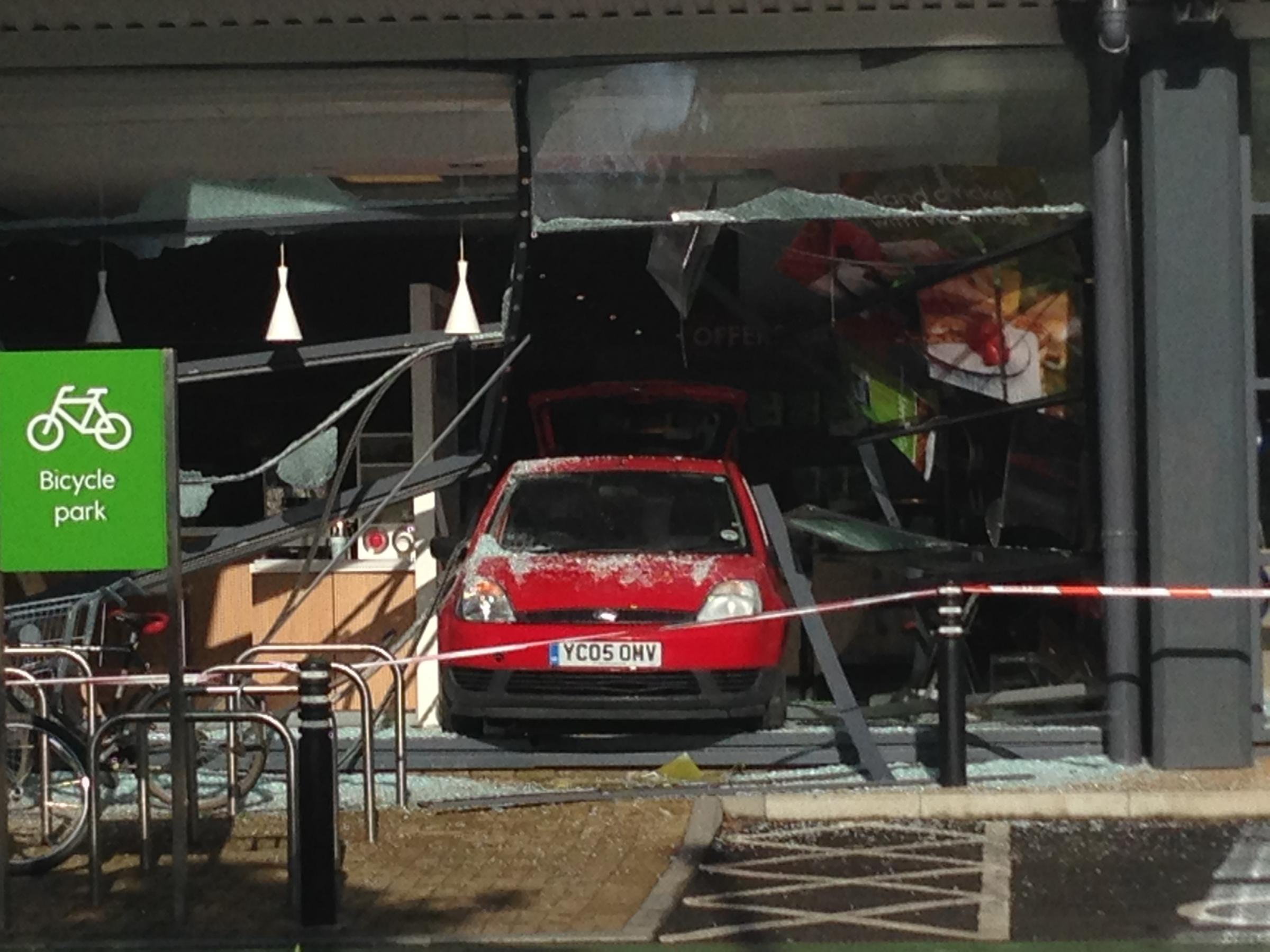 York supermarket re-opens after window smashed by car is boarded up