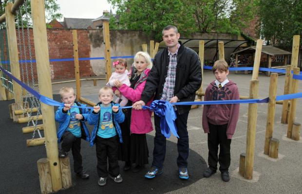 Blaise Etheridge-Clarke's parents, Theresa and Tony, with their children, from left, Zach, Jerome, Francesca and Christian at the opening of the new play equipment at St Wilfrid's School.