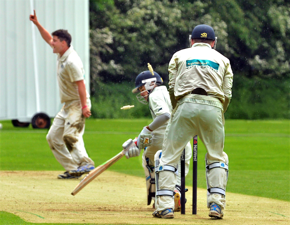 York bowler Tom Pringle celebrates after taking the wicket of Danish Hussain watched by wicketkeeper Liam McKendry