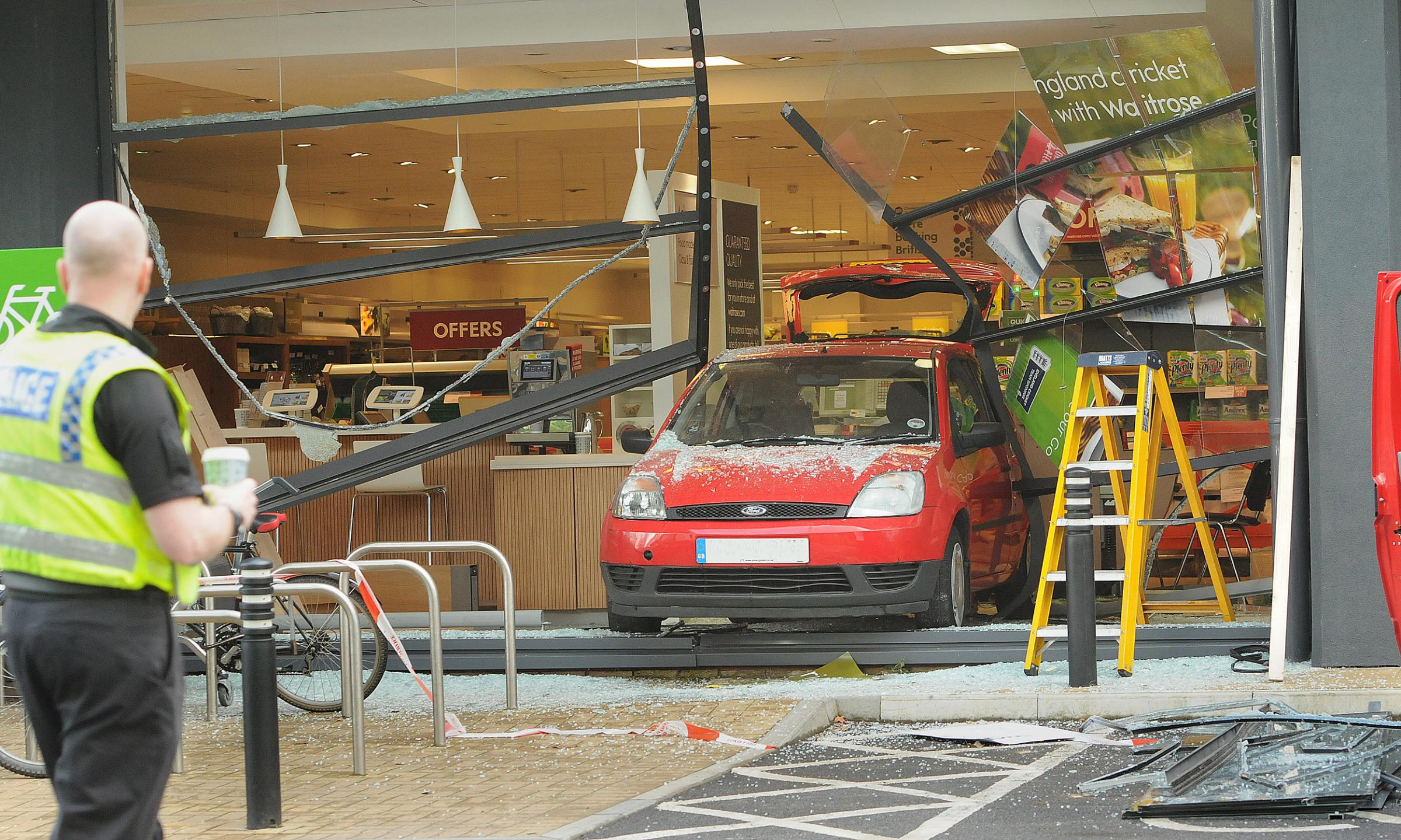 DAMAGE: The scene at Waitrose in Foss Islands Road last weekend where a woman accidently reversed her car through a window