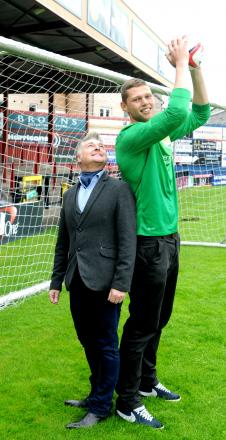 York City chairman Jason McGill welcomes goalkeeper Jason Mooney to Bootham Crescent