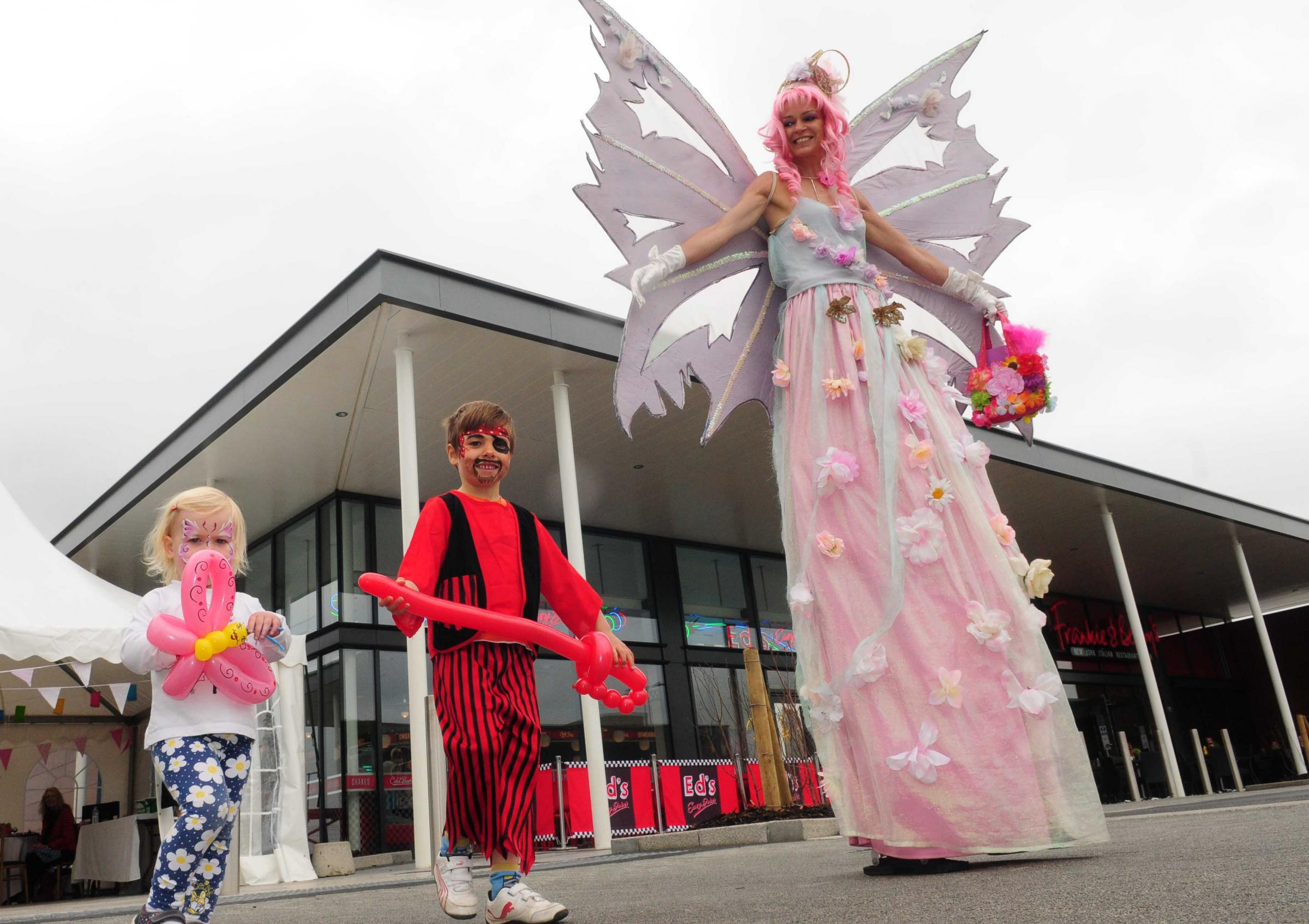 A fairy stilt walker entertains youngsters during the fun day at York's Vangarde shopping park
