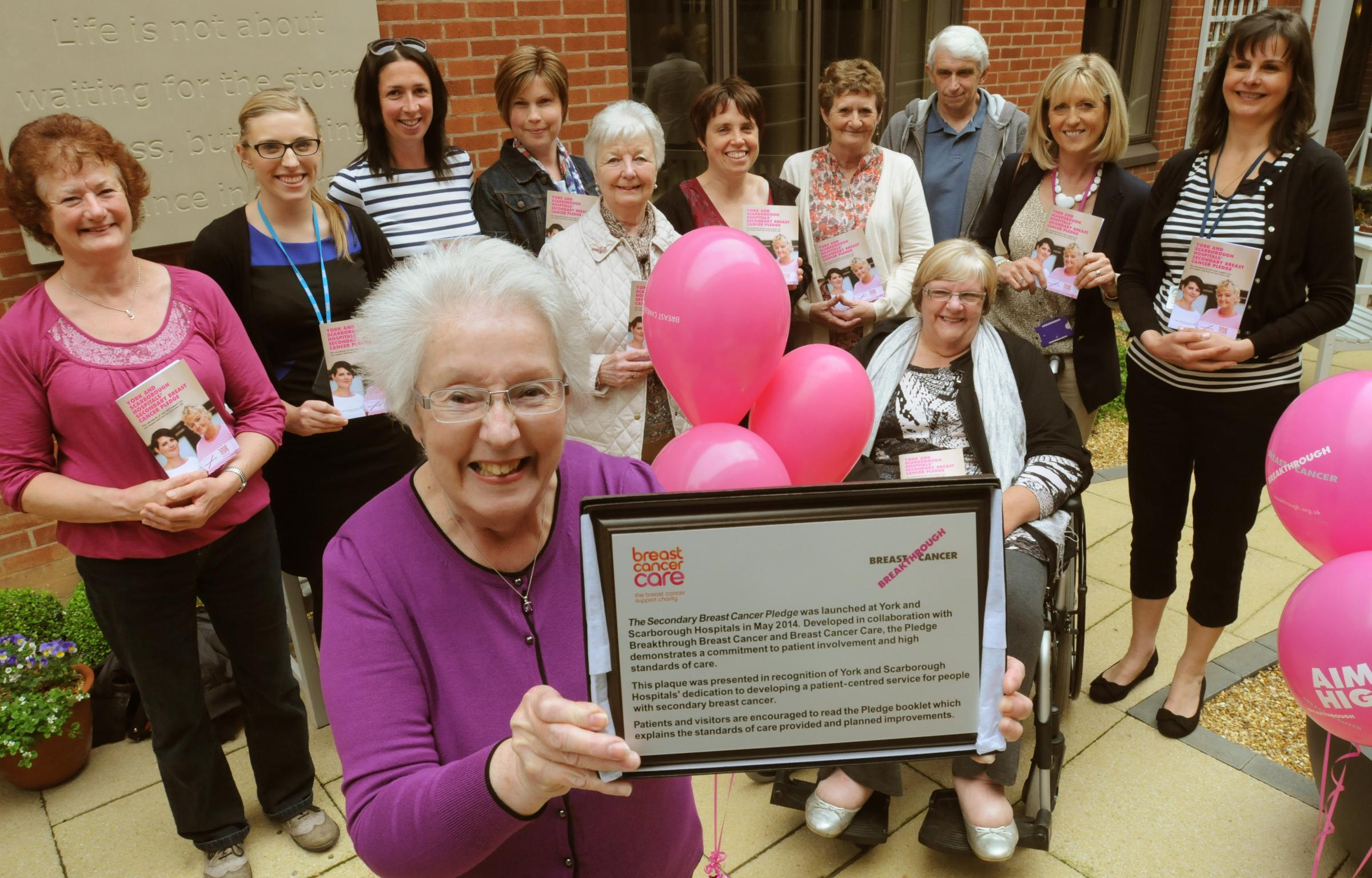 Patients and staff at the York Hospital Cancer Care Centre mark two of the UK's leading breast cancer charities-Breakthrough Breast Cancer and Breast Cancer Care teaming up with York and Scarborough Hospitals to improve services