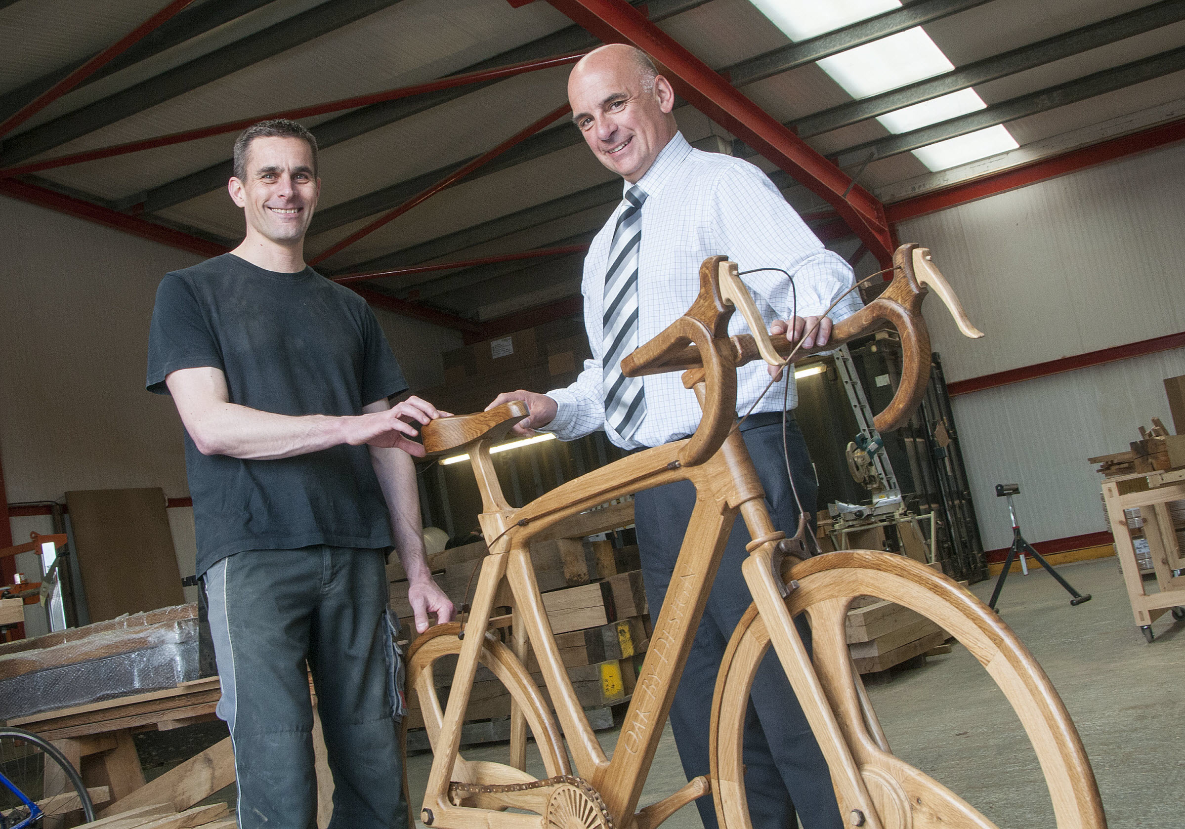 OAK FRAME:Richard Penny of Oak By Design, left, and Gary Whitaker from Lloyds Bank Commercial Banking