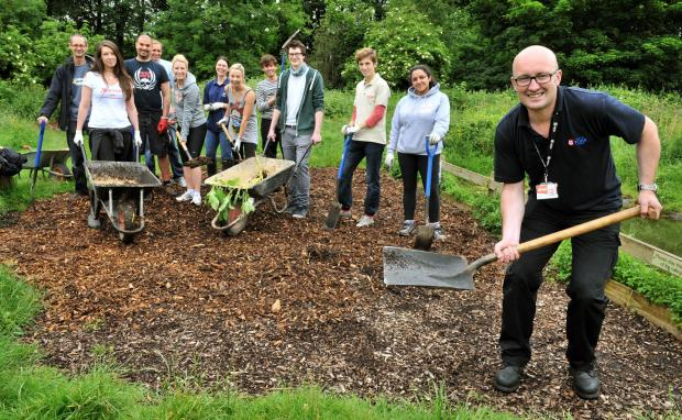 Iain Dunn from City of York Council working with York Cares volunteers from Aviva and The Marriot Hotel at Rowntrees Park