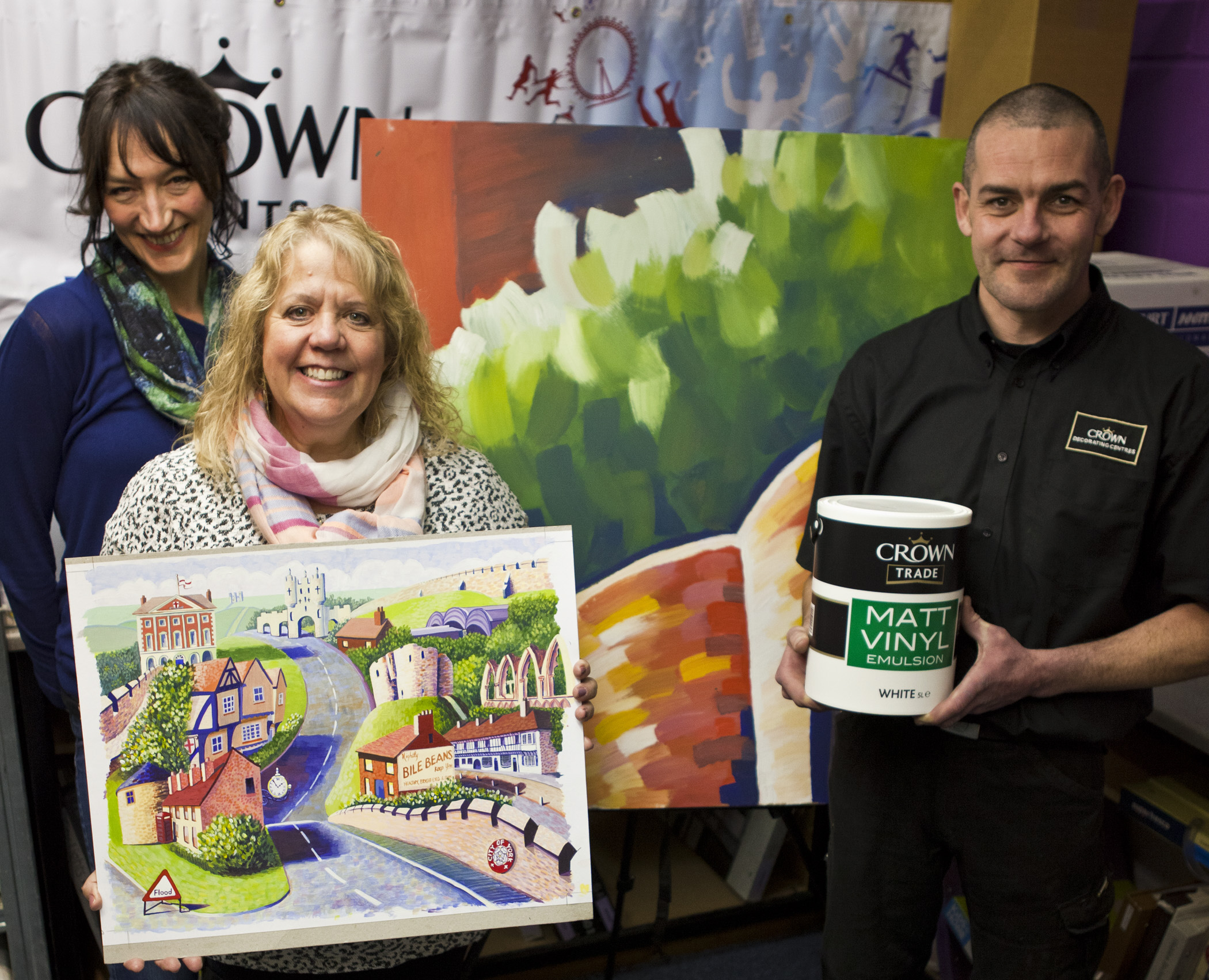 Co-ordinator Claire Douglas, artist Karen Winship and Crown Decorating Centre manager Peter Carr with the Road Through York painting