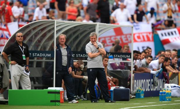 York Press: England manager Roy Hodgson, centre of picture, watches on from the dugout during the Three Lions' World Cup warm-up match against Ecuador in Miami, in which he selected a much-changed line-up to that which beat Peru at Wembley on Friday