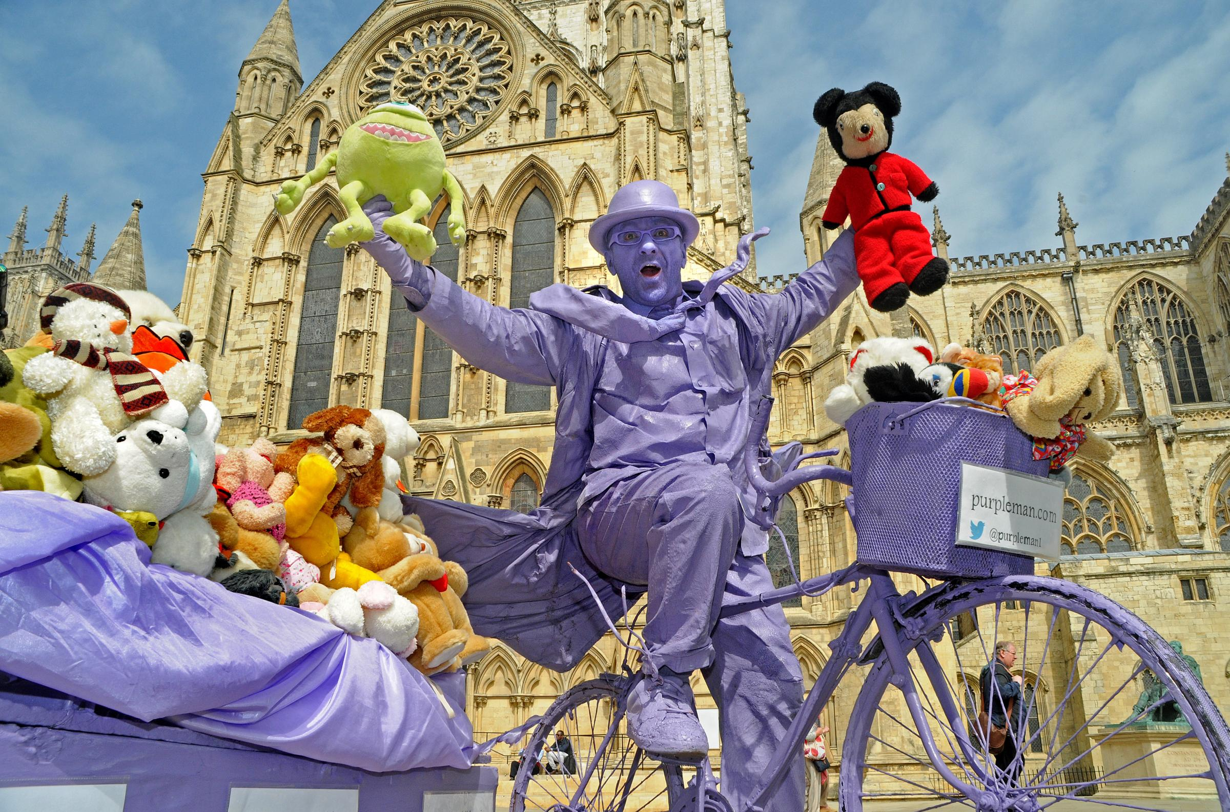 Purpleman with some of the 1,000 soft toys donated by York residents for the children of war-torn Syria