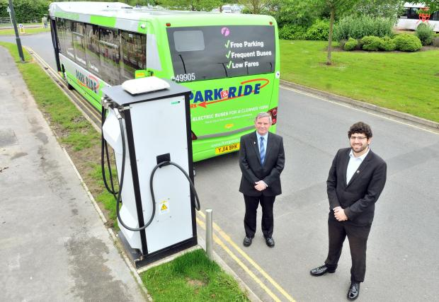 Cllr David Levine,right, and and Peter McCarthy of First York with an electric bus at its charging point at The Vanguard Centre Monks Cross