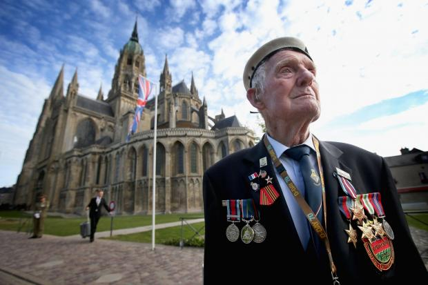 D-Day Veteran 88-year-old Victor Walker, formerly of HMS Versatile, arrives at Bayeux Cathedral for a service of remembrance during D-Day 70 commemorations on June 6, 2014 in Ranville, France