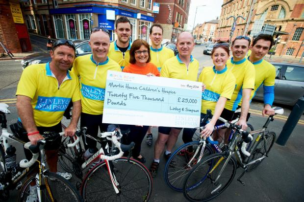 The nine cyclists from Linley & Simpson with Brenda Peel, corporate fundraiser for Martin House Hospice