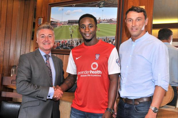 York City chairman Jason McGill, left, with new signing Marvin McCoy and assistant manager Steve Torpey