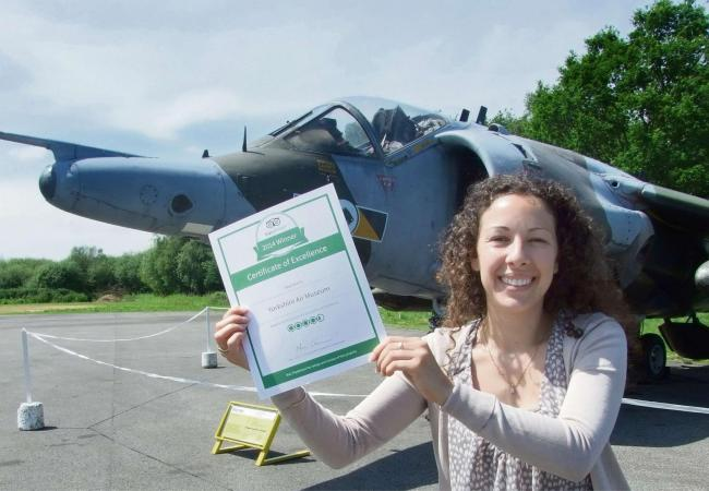 "Museum PA and ""Bureau Français"" Sandrine Bauchet with the new certificate alongside the Museum's Hawker Harrier Jump Jet."