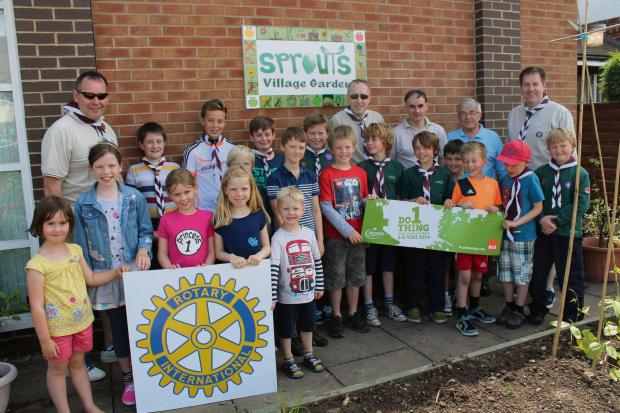 Members of Copmanthorpe Cubs, Scouts and leaders, the Sprouts Community Garden and York Ainsty Rotary club