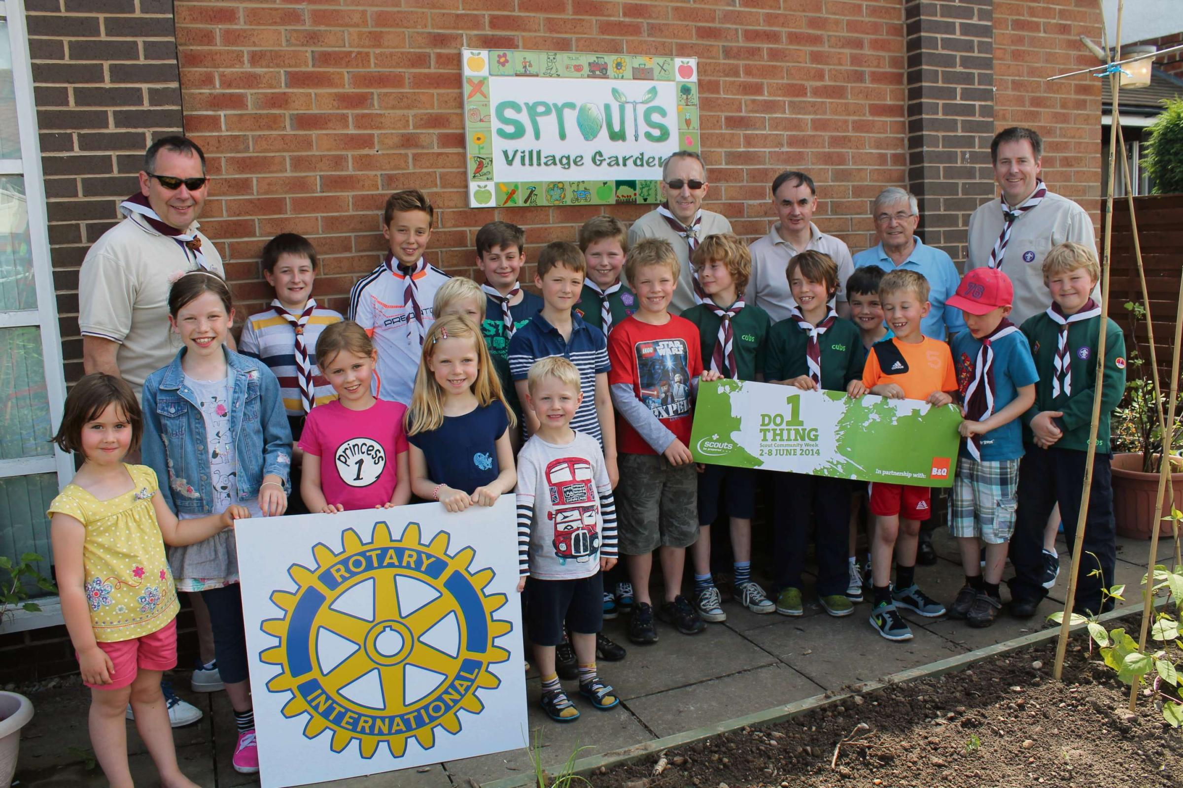 Copmanthorpe Cubs, Scouts and leaders, with children from Sprouts and a representative from York Ainsty Rotary at Sprouts Community Garden.