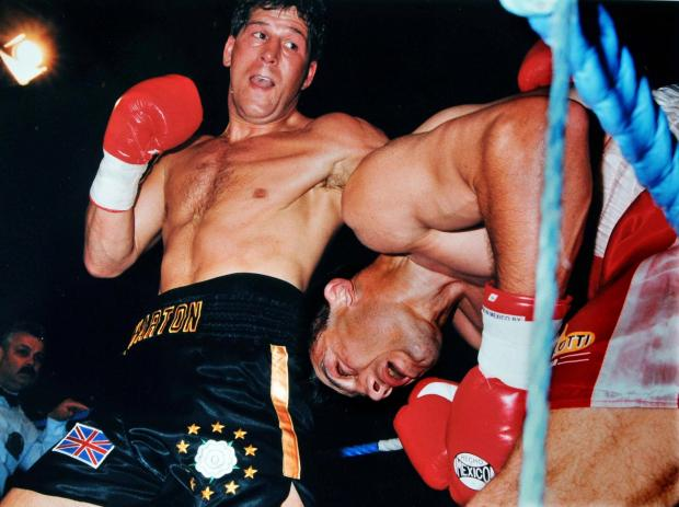 Henry Wharton hammers his opponent, Italy's Mauro Galvano, into submission at the Barbican to win the European super-middleweight crown in 1995