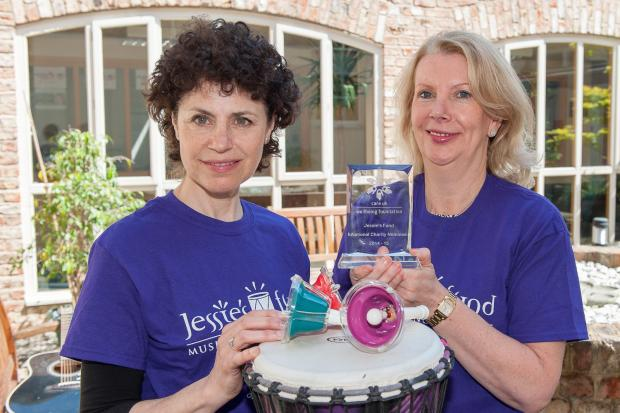 : Lesley Schatzberger, from left, founder of Jessie's Fund, is presented with the National Nominee trophy by Karen McCormick, group HR director at Care UK