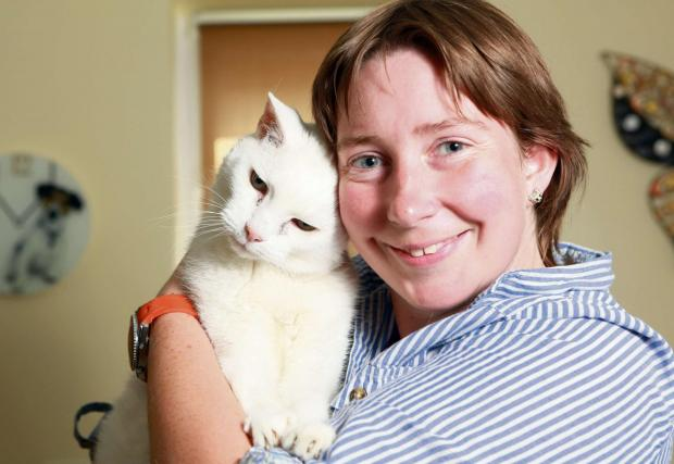 Snowy, thought to be the oldest cat in the world at 27 years old, pictured with owner Claire Wills, from Boroughbridge