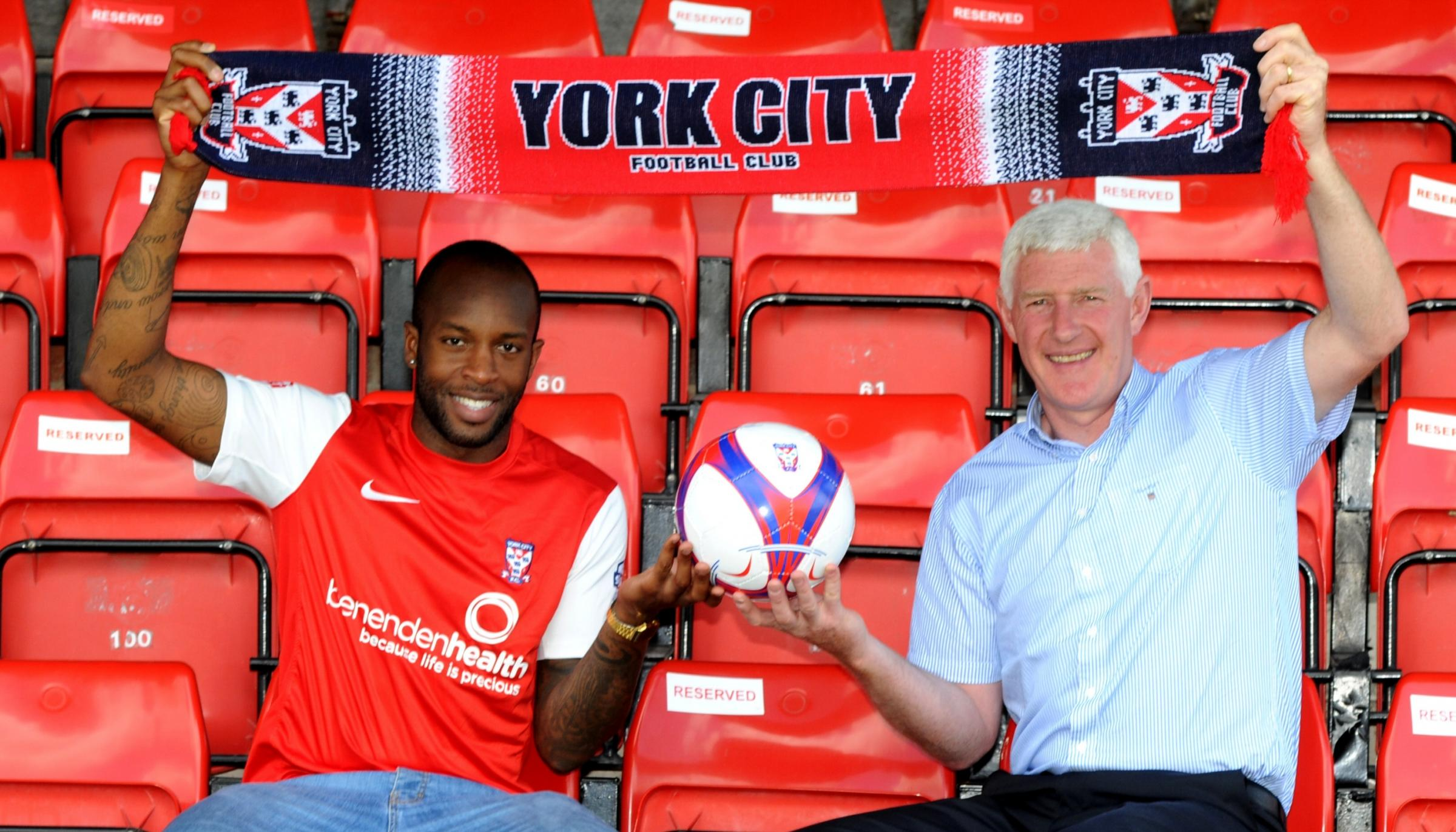 New signing Anthony Straker is pictured with York City manager Nigel Worthington after signing a two-year contract at Bootham Crescent