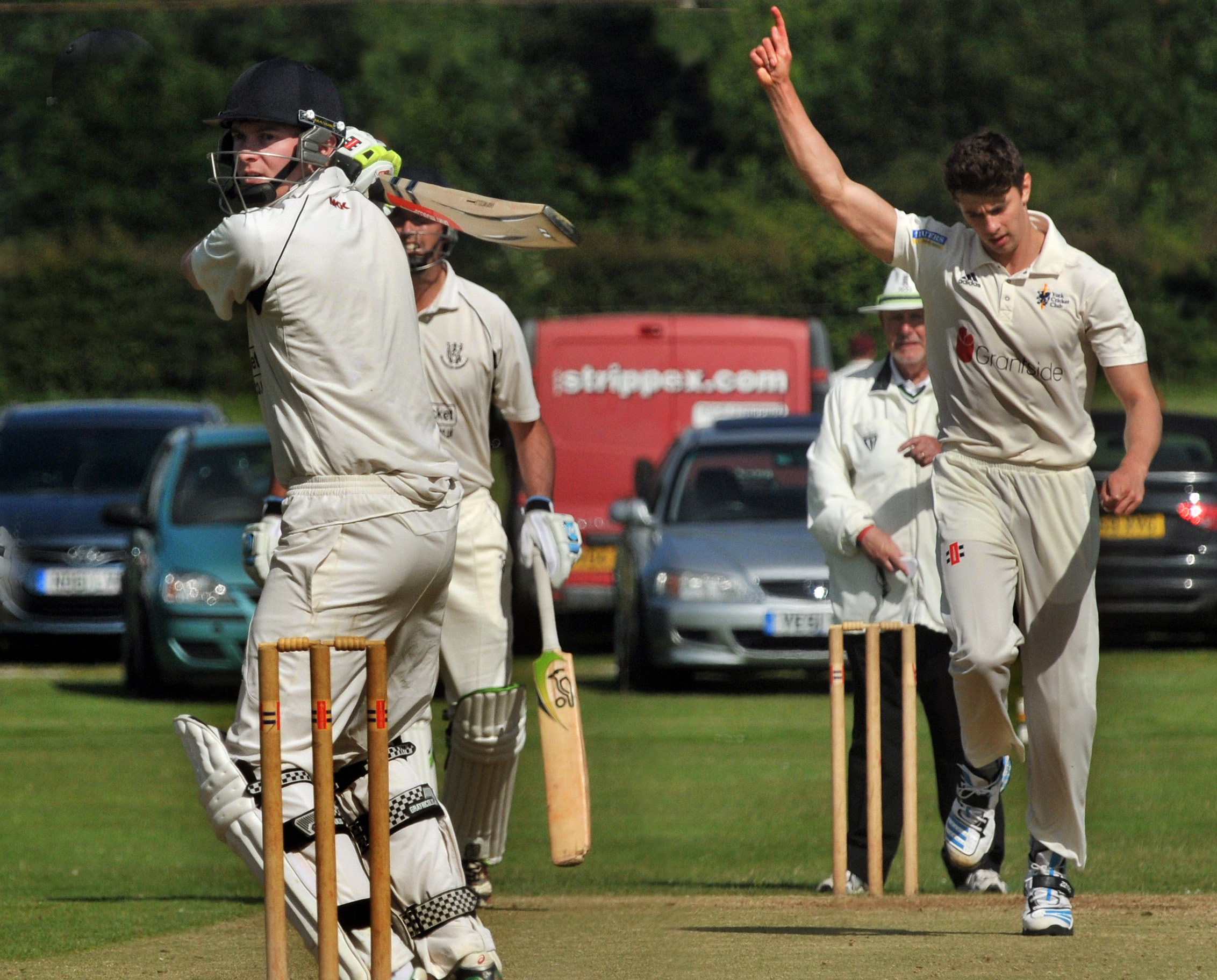 RULED OUT: Jonny Moxon, pictured celebrating taking the wicket of Andrew Bilton in a previous meeting with Woodhouse Grange, will be missing for York during this weekend's top-of-the-table Hunters ECB Yorkshire Premier League North clash. Picture: Nigel
