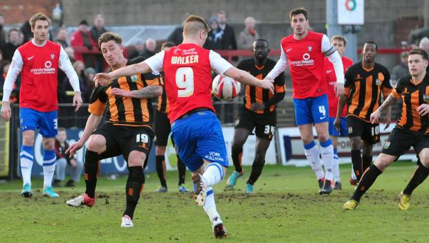 New  signing  Jake Hyde, pictured in action for former club Barnet against current employers York City, is looking forward to making a big impression with the Minstermen in League Two next season