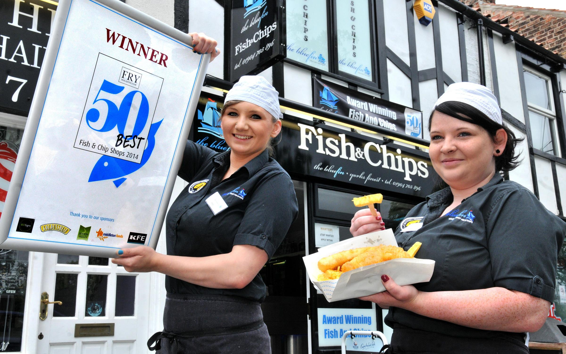 Katie Meloy (left) and Danii Shannon with the award at Blue Fin, Tadcaster Road.