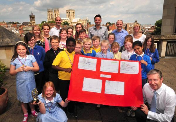 Amy Moore, front left, with David Barral, of Aviva, alongside fellow Tang Hall school pupils and Aviva staff and student volunteers