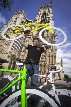 Adam Thompson of Revelry Cycles with his Tour de France bikes