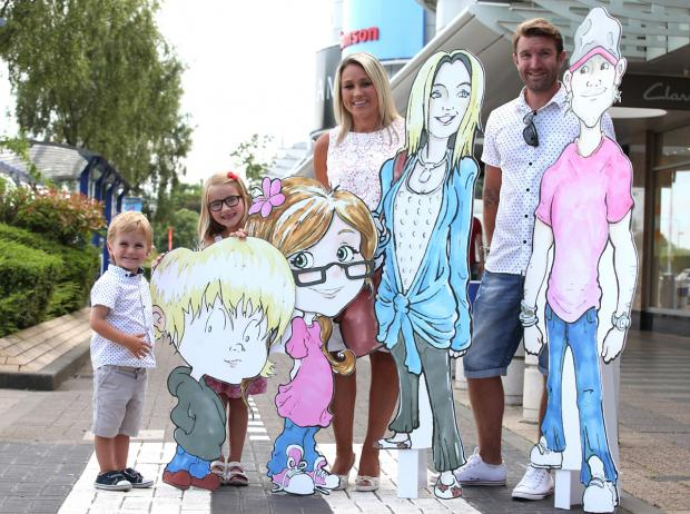 Nicola Robins, her partner James Newton, and children Halle-Rose and Oliver, with their cardboard cutouts at Monks Cross Shopping Park