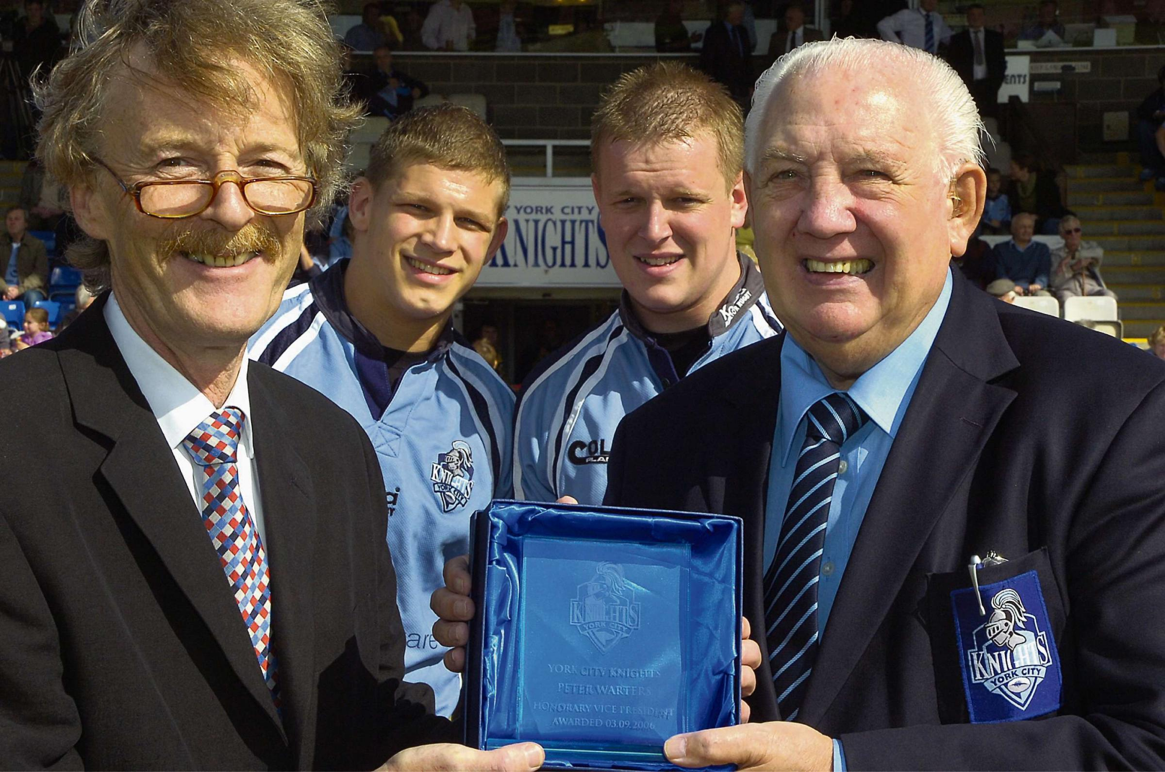 YORK RUGBY LEGEND: Pete Warters, right, is presented with his York City Knights Honorary Vice-Presidency in 2006 by the then club chairman Roger Dixon, watched by his grandsons Peter Fox and Jonny Liddell, both Knights stars at that time