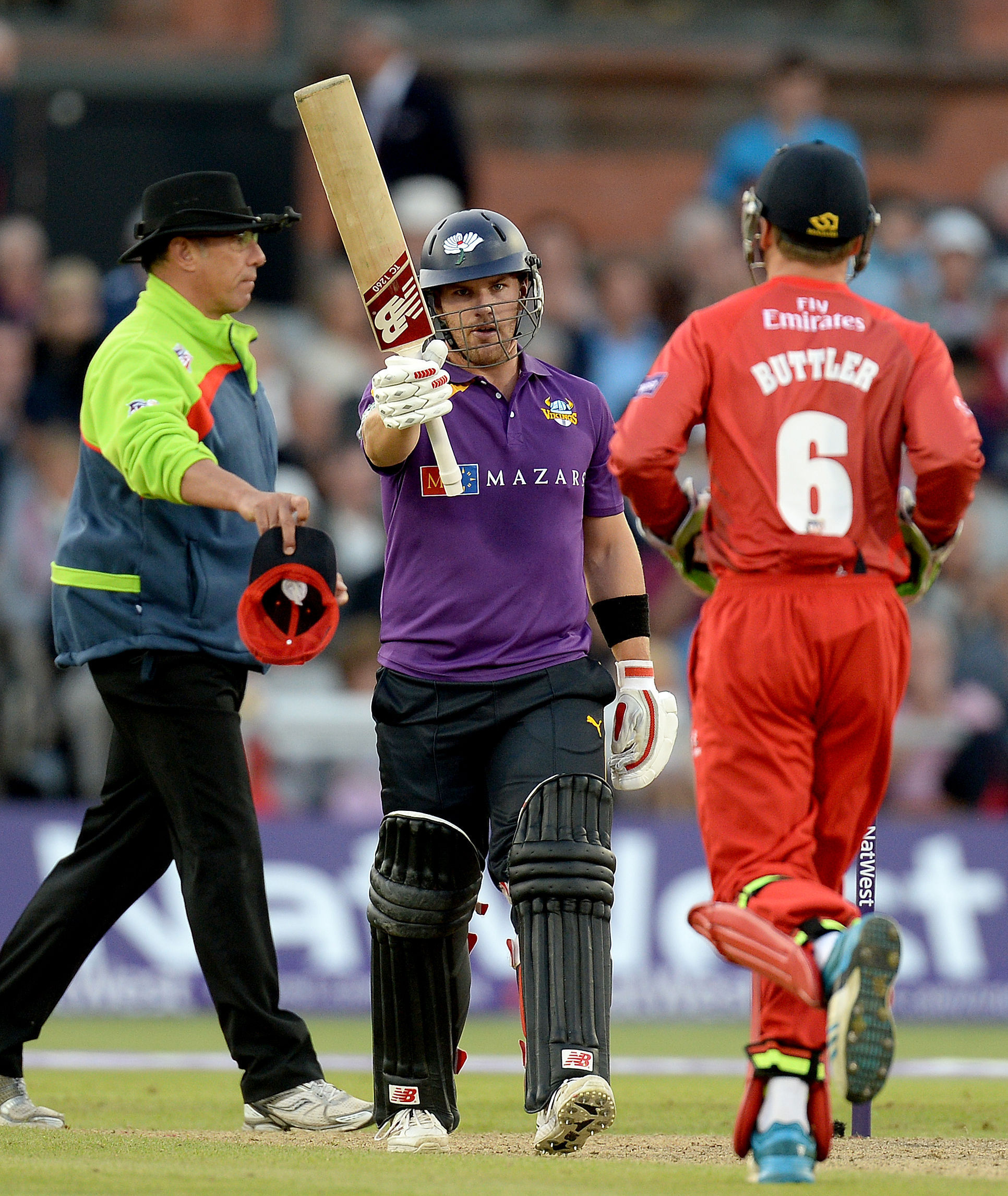 Yorkshire Vikings Aaron Finch (centre) celebrates his half century against Lancashire Lightning,during the NatWest T20 Blast match at Emirates Old Trafford, Manchester.