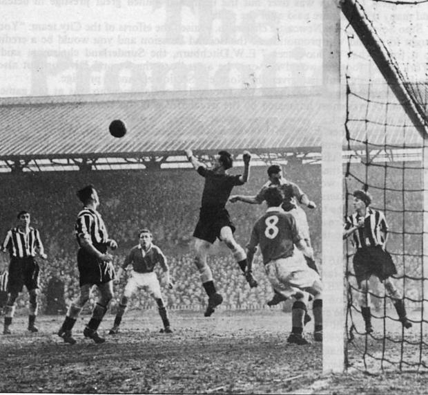 Goalkeeper Ronnie Simpson punches clear a York City corner in the 1954-55 FA Cup replay. City players are, from left, Norman Wilkinson, Billy Fenton and Arthur Bottom