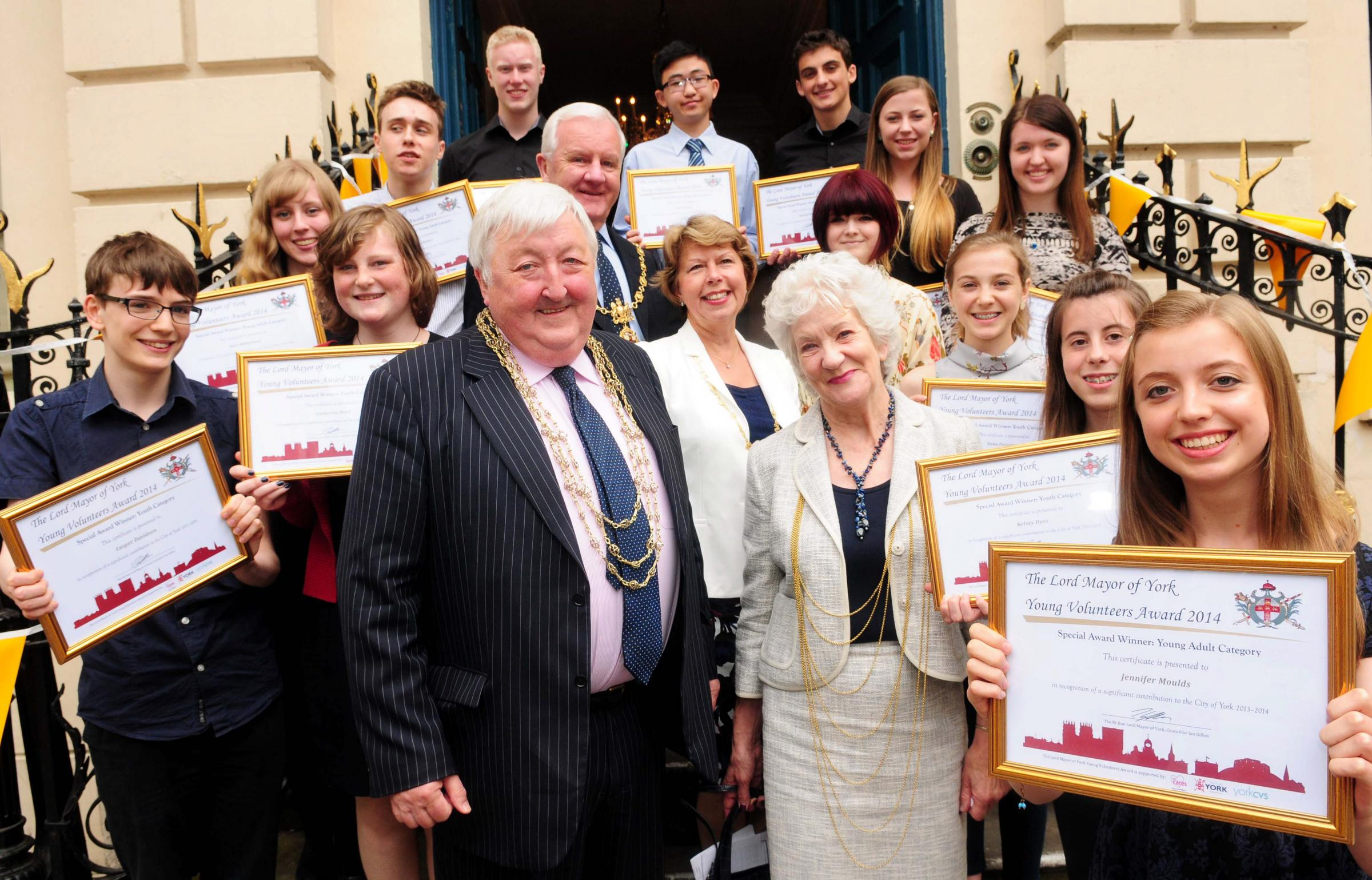 The civic Party including Lord Mayor Cllr Ian Gillies and his wife, Pat, are joined by Young Volunteers Award winners including Jennifer Moulds (front) on the steps of The Mansion House following the awards ceremony.