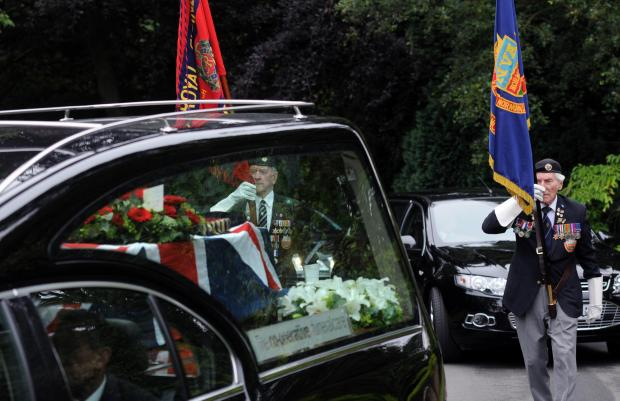 York Press: A guard of honour follows Normandy veteran Roy Rowbotham's coffin as the cortege arrives at York Crematorium for the funeral.