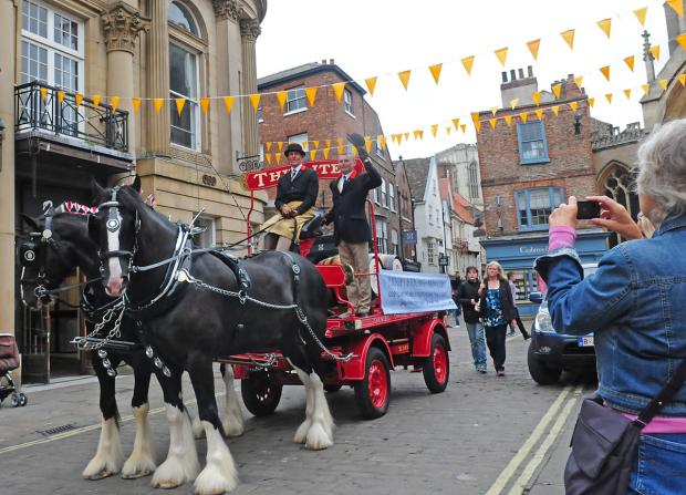 A traditional dray pulled by shirehorses arrives in York to mark the opening of the Judge's Lodgings pub following a major refurbishment