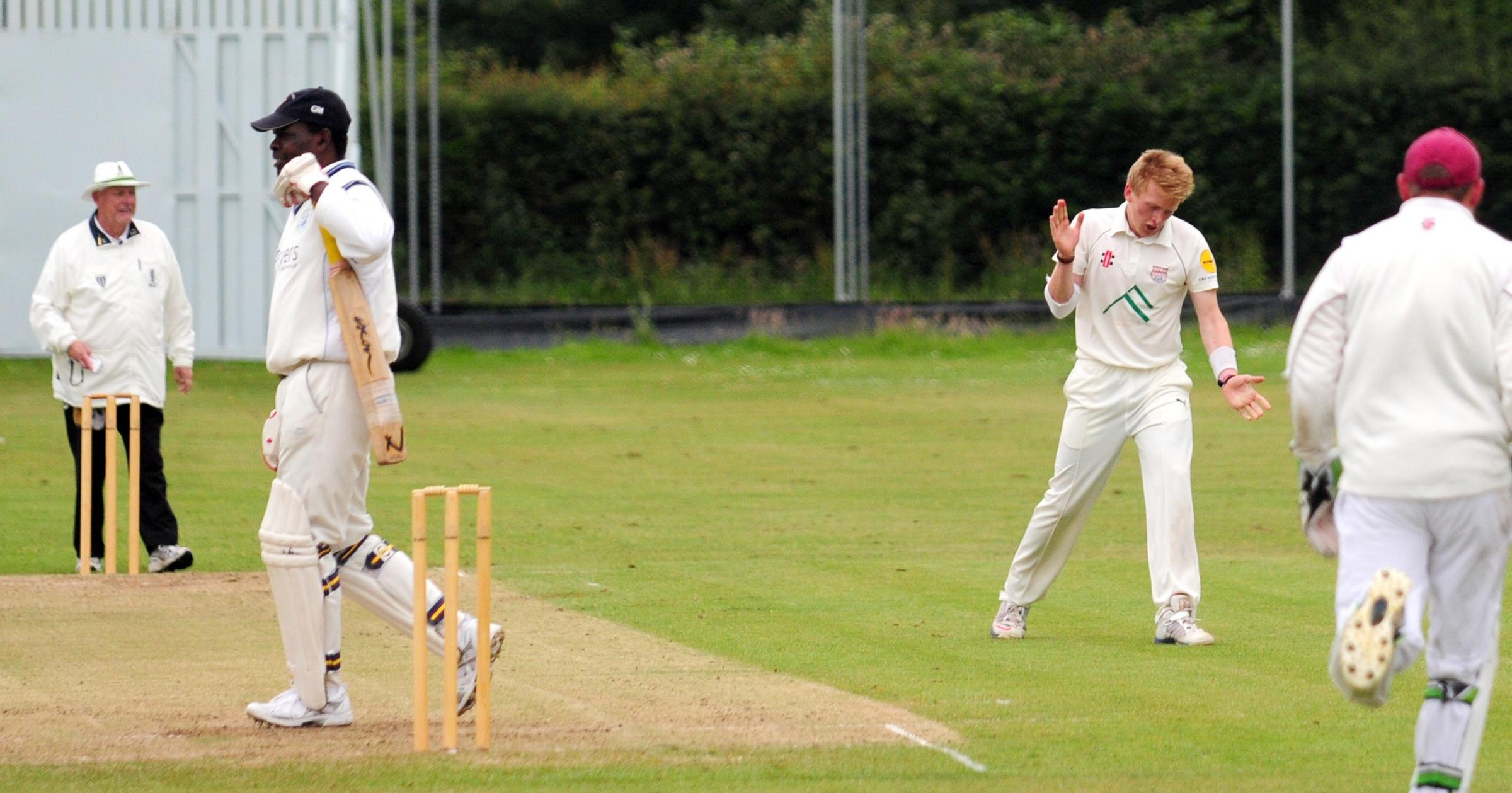 It's sheer delight for Sheriff Hutton Bridge opening bowler Eddie Barnes, left, after capturing the prized wicket of Dunn