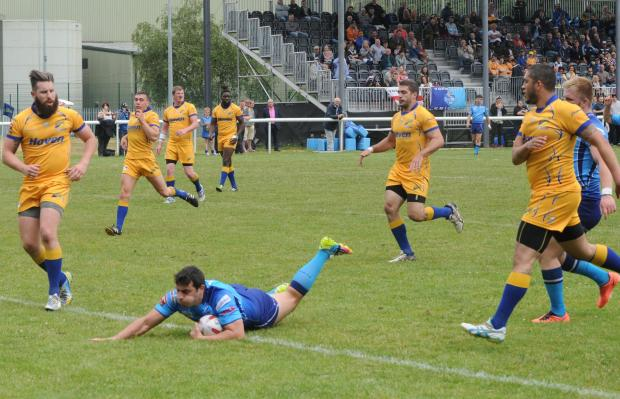 York City Knights captain Jack Lee flies in for a try against Hemel Stags