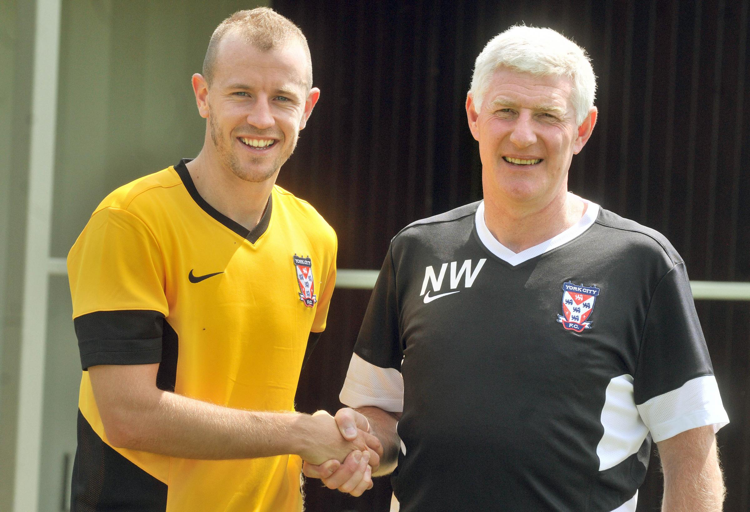 Midfielder Luke Summerfield with York City manager Nigel Worthington after joining the Minstermen from Shrewsbury