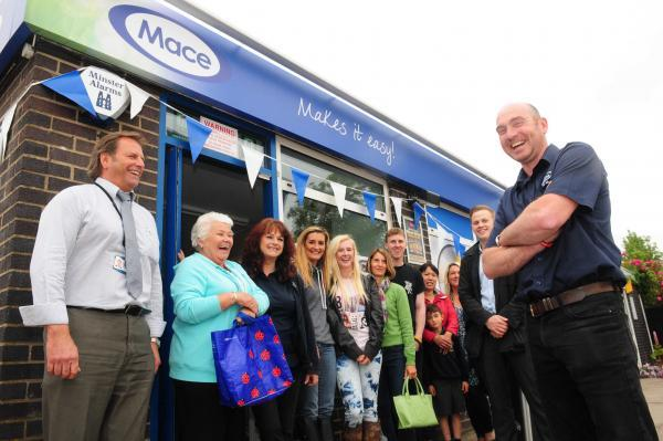 Mike Nicholls, front right, with residents and staff at the opening of the new Mace shop in Copmanthorpe, York