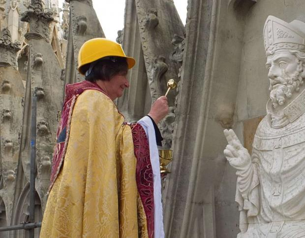 ON HIGH: The Dean of York, the Very Reverend Vivienne Faull, wearing a hard hat, dedicating the statue of St Peter