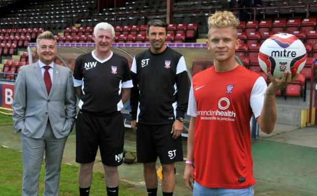 York City signing Lindon Meikle with, from left, chairman Jason McGill, manager Nigel Worthington and assistant manager Steve Torpey