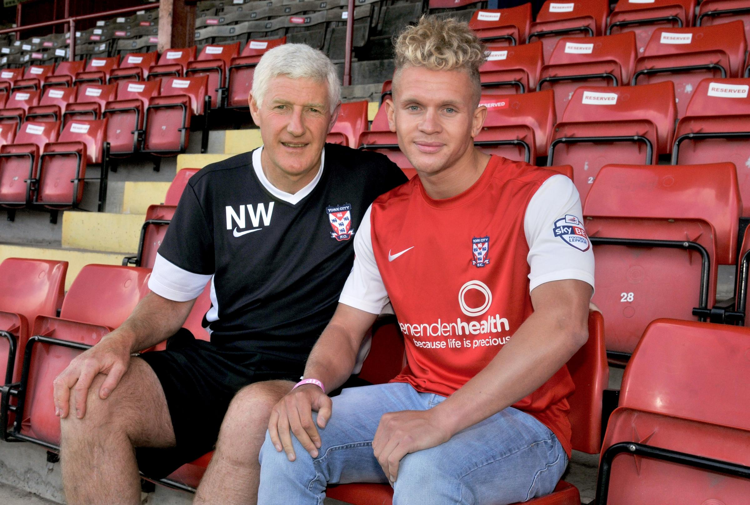 HAPPIER TIMES: Lindon Meikle is welcomed to York City by former manager Nigel Worthington.
