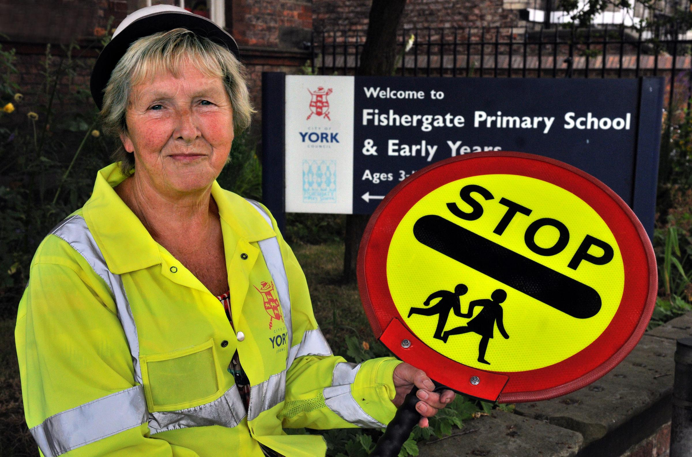 Lollipop lady Joyce Donkin was recognised for being a public-sector hero with her hard work.