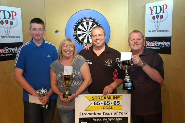 From left to right, youth champion Dean Spenlow, ladies' title winner Jo Hodges, Phil Good of tournament organisers York Darts Organisation, and men's victor, Terry Temple