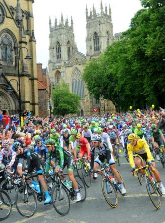 The Tour De France arrives at Duncombe Place in the shadow of York Minster this morning